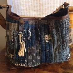 Rustic worn denim and leather bag from J. Augur Designs.