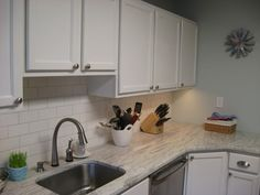 Like the white cabinets, white subway tiles and white granite look with stainless