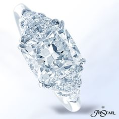 Style 4912 Gorgeous 3.42ct cushion-cut diamond embraced by half-moon and shield diamonds, handcrafted in platinum