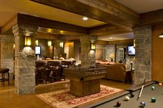 showcase 2008 traditional basement I like the beam going around bar to separate it
