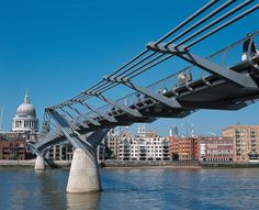 Walking the Millennium Bridge is a perfect spot for a family photo in London.