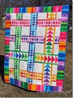 Really love Flying Geese quilts! Id use more muted colors though. Maybe batiks!
