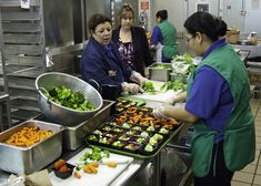 https://flic.kr/p/ayDVMz | 20111019-FNS-RBN-1694 | From left: Jackie Nampha, Manager, Washington-Lee High School Cafeteria, Amy Maclosky, Director, Arlington Public Schools, Food and Nutrition Services and Rosalba Gomez, cafeteria staff discuss the lunch service of Baja Fish Taco Wraps, Turkey Hot Dogs, Cherry Tomatoes w/dip, Baked Beans and Fresh Fruit for Washington-Lee High School in Arlington, Virginia, on Wednesday, October 19, 2011. The National School Lunch Program is a federally assi...