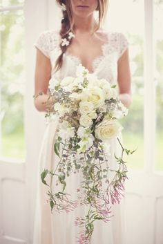 her dress is gorgeous, her hair is gorgeous, and her bouquet is gorgeous.