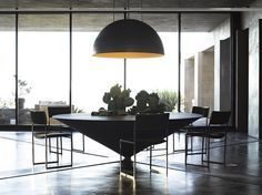 Contemporary dining room   the modern furniture is just amazing, the shape of the table is eye catching    www.bocadolobo.com #diningroomdecorideas #moderndiningrooms