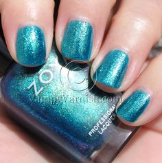 Zoya: Charla. It's an ocean blue with gold and blue shimmer. It's got a green and purple flash to it you can't really see in this pic.