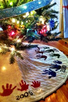 Handprint Christmas Tree Skirt   One of my favorite keepsakes
