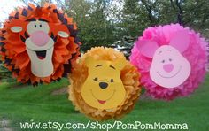 Tissue pom pom...like how tigger's face is on this pom pom could def. make it out of foam pieces.