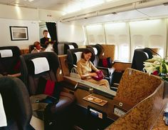 British Airways first-class cabin features champagne, large seats and more than 200 entertainment choices. Passengers are also served afternoon tea. How British. (British Airways)