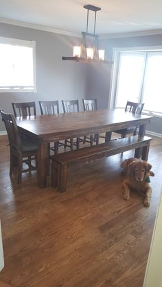 "James+James 8'x42"" Farmhouse Table with a custom Red Oak table top. This table has a traditional, boarded table top all stained in Vintage Dark Walnut. Pictured with matching Farmhouse Bench and 6 mat (Vintage Top Table)"