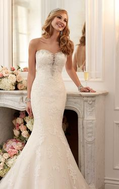 Stella York #6119 - Lace of satin fit and falre gown with an illusion plunging sweetheart neckline. Beaded bodice.