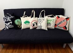 Tote Bags as Throw Pillows: What a great idea for that abundance of eco-friendly bags!