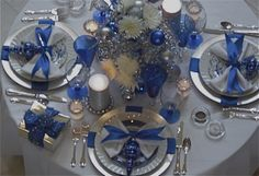 Beautiful blue & silver Christmas table. We've used blue, silver & black for New Years as well