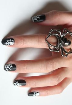 Try this spooky Halloween nail art!