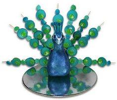 Peacock cake with cake pop fan tail.  Created by Miya @ Jellyfish - Jelly Crafty Ideas.  Source:  joyfulstamper.blogspot.com