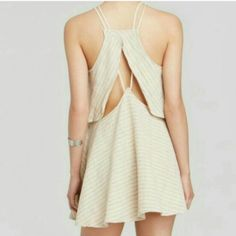 NWT Sexy Free People cream/tan tulip dress Brand new Free People tulip A-line dress. Material is a linen blend and the back has a cute peek-a-boo cutout with double rope straps. The color is a creamy ivory. This dress swings as you turn and is super flirty. Size Medium, meant to be worn loose. No paypal or trades. Free People Dresses