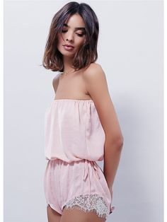 Pretty Little Things Romper | Semi sheer strapless romper with elastic waist. Double tie accent at the waist and lace trim at the hips.