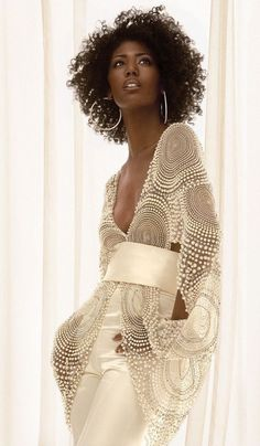 Pretty, delicate. love. Looks like New Years Eve to me. Beaded perfection super cute concentric rings in studs and pearls be cute for skirt overlay