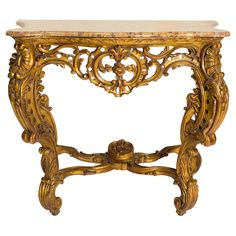 Italian Giltwood Marble Top Console | From a unique collection of antique and modern console tables at https://www.1stdibs.com/furniture/tables/console-tables/