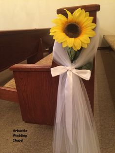 A sunflower always seems to bring happiness to any occasion! Pew decorations for a rustic wedding at Arbuckle Wedding Chapel,