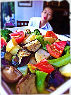 Hearty vegetables w/ a light vinaigrette....even one of our staff can`t wait to try it, making some weird faces at the salad.....poor salad