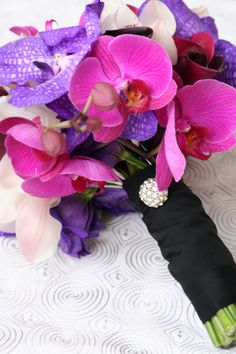 pink and purple orchid wedding flower bouquet, bridal bouquet, wedding flowers, add pic source on comment and we will update it. www.myfloweraffair.com can create this beautiful wedding flower look.