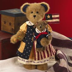 Flags are flying high for this whimsical creation that combines two of our beloved Boyds bears with the folk-art style of Jim Shore.  Wearing a dress with gathered sleeves, she features embroidered trim on the collar and tailored skirt edge. Her button-down dress is cute. America the Beautiful is the name at Boyds.