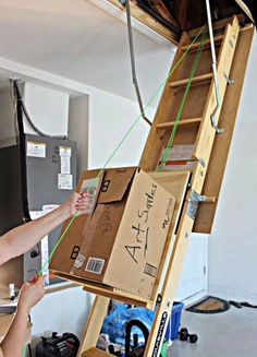 Half of the hassle with attics is trying to heave all of your boxes up into the cramped quarters — but this genius DIY makes heavy lifting so much easier. We recommend installing this before you hurt your back. See more at Instructables » Attic Organization, Attic Storage, Storage Spaces, Storage Ideas, Organizing, Woodworking Organization, Tool Storage, Garage Storage Solutions, Ceiling Storage