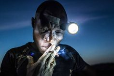 People, 2nd prize singles. A mine worker takes a smoke break before going back into the pit. Miners in Bani face harsh conditions and exposure to toxic chemicals and heavy metals. Image taken in Bani, Burkina Faso, on Nov. 20, 2015.