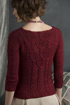 """Altered from an allover pattern worked in lace yarn, this pattern, alone and grouped on the back of the sweater, creates a delightfully elegant pullover."""