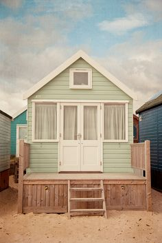 Pastel Beach Hut. ** This looks more like a small 'real' house than a beach changing hut.