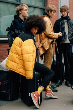 Check out all of the crossbody bags, puffer jackets, and swervy topcoats you can handle from the Fall/Winter 2018 shows in our exclusive street style gallery.