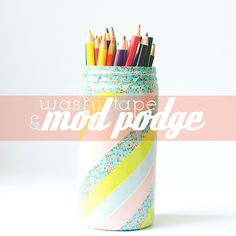 cover your old plastic containers with washi tape! re-purpose that trash into something beautiful. coat it in mod podge to make it permanent.