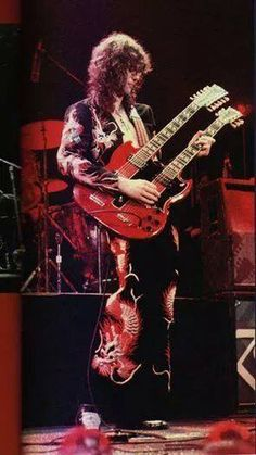 Jimmy Page, Led Zeppelin: Black Dragon doubleneck. May Earl's Court. Jimmy Page, Punk, Hard Rock, Led Zeppelin Physical Graffiti, El Rock And Roll, Rock Y Metal, John Bonham, Greatest Rock Bands, We Will Rock You