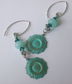 Designed by Norbel Marolla using my patinized brass sunflower components.  Her choices in bead color and the shape of these earwires are a really nice touch!  7/2013