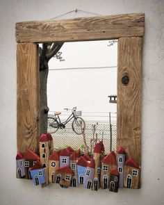 "Instead of using ordinary moulding around windows .. use old wood to ""frame"" the window."