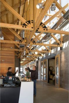 Clerestories soar above the August Cellars tasting room, with barrel rooms tucked underground.