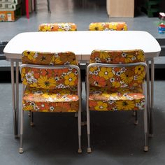 Bring on the flower power with this adorable vintage dinette set. This set includes four chairs with bright floral graphics on the seats and back rests in autumnal shades of yellow, beige, and orange. Presented by Whisky Ginger, the chairs feature simple metal legs that pair well with their busy prints. Put these pieces around a white table for some groovy floral fun, minus the hay fever.