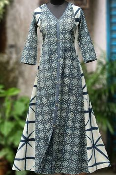 a v-neck a-line dress in indigo clamp dye & ajrakh with minimal mirror embroidery & ajrakh trims! Salwar Designs, New Kurti Designs, Kurta Designs Women, Kurti Designs Party Wear, Stylish Dresses, Fashion Dresses, Cotton Long Dress, Sleeves Designs For Dresses, Baby Dress Patterns