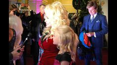 """From Hollywood to Dollywood, the red carpet rolled out in East Tennessee Tuesday for the premiere of Dolly Parton's new movie """"Christmas of Many Colors: Circle of Love."""""""