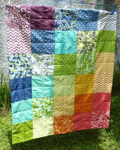 Rainbow quilt made with a simply color layer cake