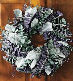 """Eucalyptus Wreath by Wind & Weather. $34.95. Eucalyptus Wreath. Floral artisans in California hand-arrange this wreath to emanate lush, soothing color and a refreshing fragrance. Generous clusters of eucalyptus stems, lilac, sage, white lepto, and white salal are woven to a natural twig base. All flowers and foliage are naturally grown and preserved to be the finest in the field. Size 17"""" Dia. Shipping Allow 2-3 weeks for delivery."""