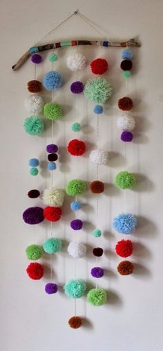 DIY Crafts with Pom Poms - DIY Driftwood Pom Pom Wall Hanging - Fun Yarn Pom Pom Crafts Ideas. Garlands, Rug and Hat Tutorials, Easy Pom Pom Projects for Your Room Decor and Gifts http://diyprojectsforteens.com/diy-crafts-pom-poms