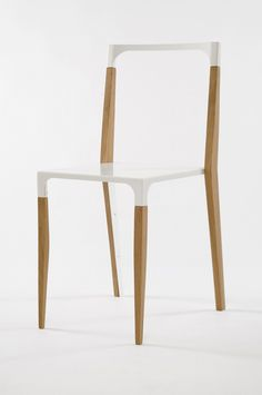 Tabbed dining chair - the backrest looks uncomfortable, but I like the slender timber legs and white/timber combination