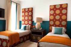 Colorful bedroom with a Moroccan interior and two tall headboards with matching designs