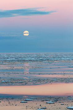 Full moon on frozen sea by Marco Gaiotti