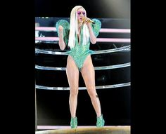 Lady Gaga emerged onstage during the 52nd Annual Grammy Awards held at Staples Center on January 31, 2010 in Los Angeles, California in a green crystal covered bustier with exaggerated rounded shoulders.