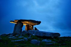 Poulnabrone Dolmen is a portal tomb in the Burren, Ireland, dating back to the Neolithic period, between 4000 BC to 2400 BC. It is believed that the first full-time inhabitants of the Burren were farmers who arrived around 3800 BC.