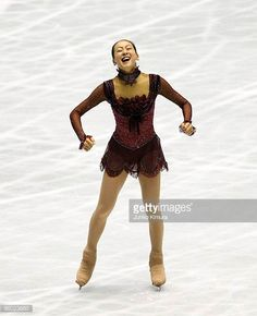 Mao Asada of Japan competes in the Ladies Free Skating during the ISU World Team Trophy 2009 Day 3 at Yoyogi National Gymnasium on April 18 2009 in. Figure Skating Dresses, Sports Figures, Burgundy Dress, Olympians, Ice Skating, Skate, Wonder Woman, Cosplay, Costumes