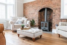 A beautiful living room design where exposed brick and soft natural dressings combine with the warm rustic tones of Urban Nature Fired Brick wood floors.